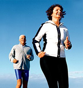 Older couple running on beach. - Copyright – Stock Photo / Register Mark