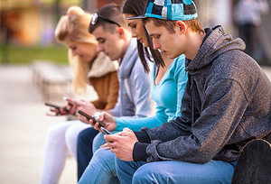 phone addiction - Copyright – Stock Photo / Register Mark