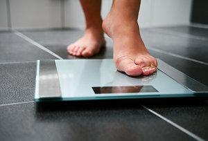 weight gain - Copyright – Stock Photo / Register Mark