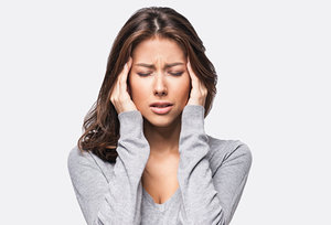 A Drug-Free Way to Treat Headaches - Copyright – Stock Photo / Register Mark