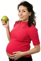 Pregnant woman holding an apple. - Copyright – Stock Photo / Register Mark
