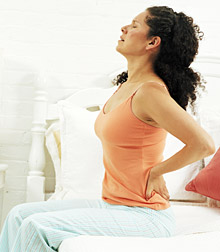 Lady having backpain - Copyright – Stock Photo / Register Mark
