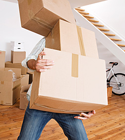 man with boxes - Copyright – Stock Photo / Register Mark