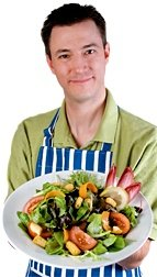Man holding large salad.
