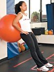 Chelsea Cooper demonstrates stability ball squats. - Copyright – Stock Photo / Register Mark