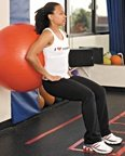 Chelsea Cooper demonstrates a stability ball squat. - Copyright – Stock Photo / Register Mark