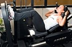 Chelsea Cooper demonstrates the leg press. - Copyright – Stock Photo / Register Mark