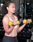 Chelsea Cooper demonstrates a proper dumbbell curl. - Copyright – Stock Photo / Register Mark