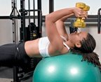 Chelsea Cooper demonstrates a tricep exercise using a stability ball. - Copyright – Stock Photo / Register Mark