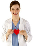 Woman in scrubs holding a paper heart. - Copyright – Stock Photo / Register Mark
