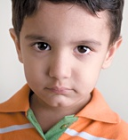The face of a depressed little boy. - Copyright – Stock Photo / Register Mark