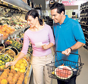 A middle aged couple shopping in the produce aisle. - Copyright – Stock Photo / Register Mark