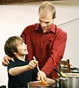 Father and son cooking together. - Copyright – Stock Photo / Register Mark