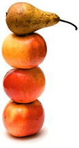 Three apples stacked up with a pear on the top. - Copyright – Stock Photo / Register Mark