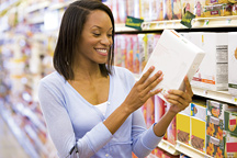 Lady at the grocery store - Copyright – Stock Photo / Register Mark