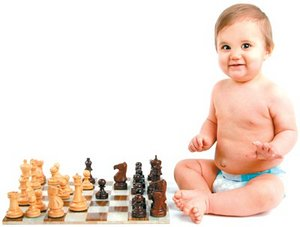 Baby sitting next to a chess set. - Copyright – Stock Photo / Register Mark