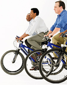 men riding bikes - Copyright – Stock Photo / Register Mark
