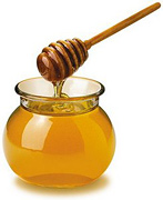 A bowl of honey. - Copyright – Stock Photo / Register Mark