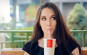 drinking soda - Copyright – Stock Photo / Register Mark