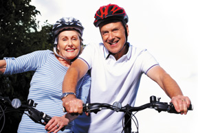 man and woman biking - Copyright – Stock Photo / Register Mark