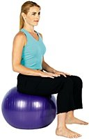 Woman sitting on exercise ball.