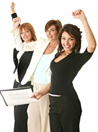 Three women holding up an arm in triumph. - Copyright – Stock Photo / Register Mark