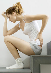 Young woman suffering from low back pain.