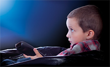 Kid watching TV - Copyright – Stock Photo / Register Mark