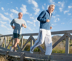 Father and son running at the beach. - Copyright – Stock Photo / Register Mark