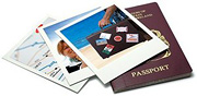 A pile of poloroid pictures and a passport. - Copyright – Stock Photo / Register Mark