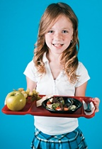 Little girl holding a caffeteria tray full of healthy food. - Copyright – Stock Photo / Register Mark