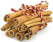 A bundle of cinnamon sticks. - Copyright – Stock Photo / Register Mark