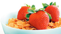 A healthy bowl of corn flakes and strawberries. - Copyright – Stock Photo / Register Mark