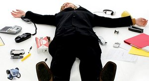 Office worker spread-eagle on the ground surrounded by office supplies. - Copyright – Stock Photo / Register Mark