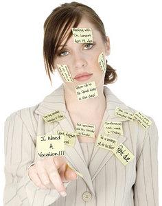 A stressed out office worker covered in post it notes. - Copyright – Stock Photo / Register Mark